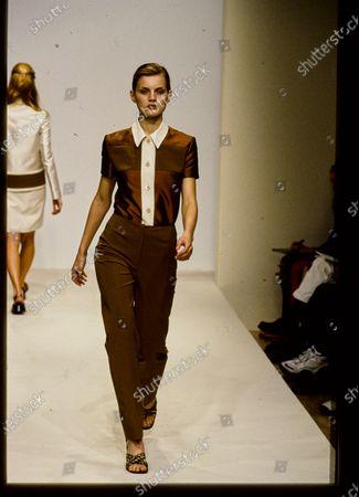 Model walks Prada's Spring 1996 RTW (pret a porter) Runway collection. Guinevere Van Seenus