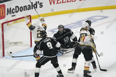 Los Angeles Kings goaltender Jonathan Quick, center, gives up a goal to Vegas Golden Knights center William Karlsson, right front, during the second period of an NHL hockey game, in Los Angeles