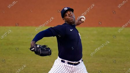 New York Yankees relief pitcher Aroldis Chapman delivers during the fourth inning of a spring training exhibition baseball game against the Philadelphia Phillies in Tampa, Fla