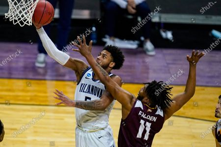 Villanova guard Justin Moore (5) shoots over Winthrop guard Charles Falden (11) in the second half of a first round game in the NCAA men's college basketball tournament at Farmers Coliseum in Indianapolis