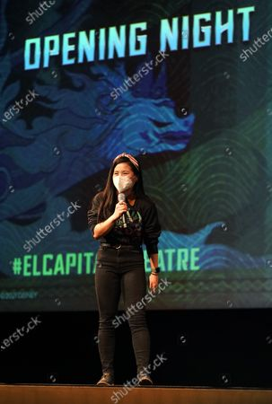 """Kelly Marie Tran, a voice cast member in the Disney animated film """"Raya and the Last Dragon,"""" introduces the film to the audience, in Los Angeles at El Capitan Theatre's reopening day following its shuttering more than a year ago due to the coronavirus pandemic. Theater reopenings are part of the entertainment industry's gradual road to recovery as states begin loosening restrictions"""