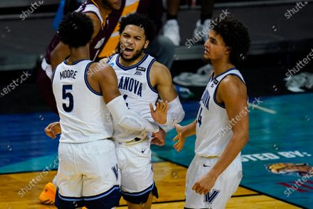 Villanova guard Caleb Daniels (14) celebrates a defensive stop with Justin Moore (5) and Jeremiah Robinson-Earl (24) in the second half of a first round game against Winthrop in the NCAA men's college basketball tournament at Farmers Coliseum in Indianapolis