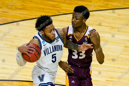 Villanova guard Justin Moore (5) drives on Winthrop forward Chase Claxton (33) in the first half of a first round game in the NCAA men's college basketball tournament at Farmers Coliseum in Indianapolis