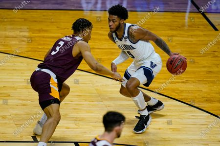 Villanova guard Justin Moore (5) drives on Winthrop guard Micheal Anemia (3) in the first half of a first round game in the NCAA men's college basketball tournament at Farmers Coliseum in Indianapolis