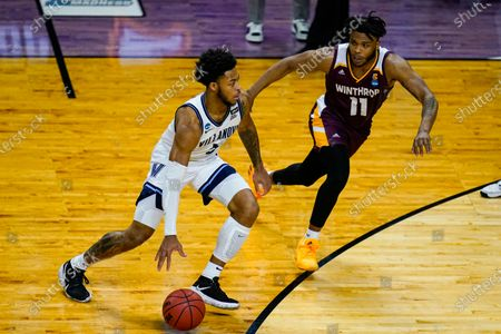 Villanova guard Justin Moore (5) drives on Winthrop guard Charles Falden (11) in the first half of a first round game in the NCAA men's college basketball tournament at Farmers Coliseum in Indianapolis