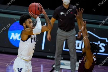 Villanova guard Justin Moore (5) shoots over Winthrop guard Charles Falden (11) in the first half of a first round game in the NCAA men's college basketball tournament at Farmers Coliseum in Indianapolis