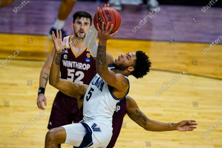 Villanova guard Justin Moore (5) shoots against Winthrop in the second half of a first round game in the NCAA men's college basketball tournament at Farmers Coliseum in Indianapolis