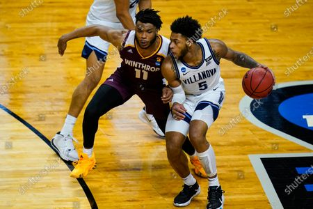 Villanova guard Justin Moore (5) drives on Winthrop guard Charles Falden (11) in the second half of a first round game in the NCAA men's college basketball tournament at Farmers Coliseum in Indianapolis