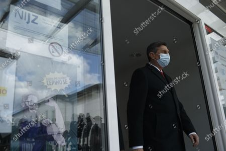 Stock Image of Slovenian President Borut Pahor leaves after receiving the AstraZeneca COVID-19 vaccine in Ljubljana, Slovenia, on March 19, 2021. Senior politicians in Slovenia were administered the AstraZeneca COVID-19 vaccine on Friday to boost public trust in vaccination.