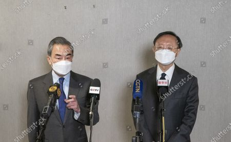 Stock Image of Yang Jiechi, a member of the Political Bureau of the Communist Party of China (CPC) Central Committee and director of the Office of the Foreign Affairs Commission of the CPC Central Committee, and Chinese State Councilor and Foreign Minister Wang Yi receive an interview with media following the end of the high-level strategic dialogue with the United States in the Alaskan city of Anchorage on March 19, 2021.