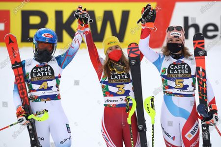 Austria's Katharina Liensberger, winner of during an alpine ski, women's World Cup slalom, poses with second placed United States' Mikaela Shiffrin, left, and third placed Switzerland's Michelle Gisin, right, in Lenzerheide, Switzerland