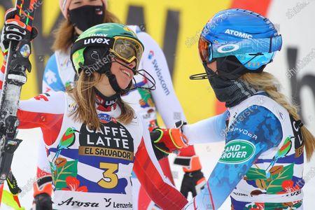 Austria's Katharina Liensberger, left, is congratulated by second placed United States' Mikaela Shiffrin after winning an alpine ski, women's World Cup slalom in Lenzerheide, Switzerland