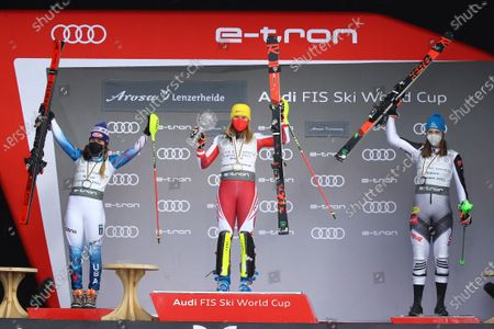 Austria's Katharina Liensberger, center, winner of the alpine ski, women's World Cup slalom discipline title, poses on the podium with second placed United States' Mikaela Shiffrin, left, and third placed Slovakia's Petra Vlhova, in Lenzerheide, Switzerland