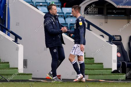 (L) Gary Rowett of Millwall shakes hands with Jed Wallace after his substitution during the Sky Bet Championship, Championship match between Millwall and Middlesbrough at The Den in London - 20th March 2021