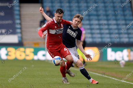 Jon Dadi Bodvarsson of Millwall and Grant Hall of Middlesbrough in action during the Sky Bet Championship, Championship match between Millwall and Middlesbrough at The Den in London - 20th March 2021