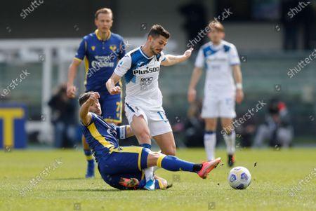 Verona's Miguel Veloso tackles Atalanta's Remo Freuler.