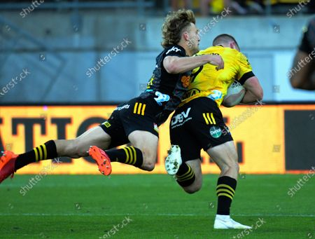 Hurricanes' Luke Campbell scores in the flying tackle of Damien McKenzie