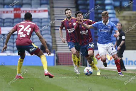 Stock Photo of Michael Jacobs of Portsmouth under pressure during the EFL Sky Bet League 1 match between Portsmouth and Ipswich Town at Fratton Park, Portsmouth