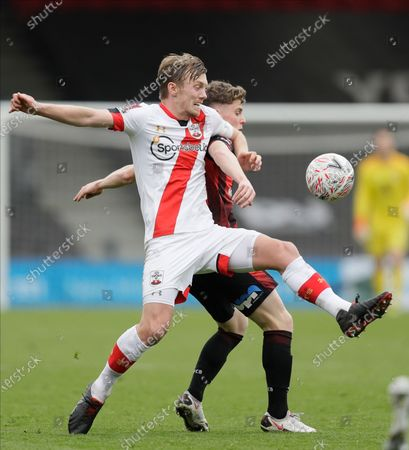 Southampton's James Ward-Prowse, left, and Bournemouth's Gavin Kilkenny challenge for the ball during the English FA Cup quarterfinal soccer match between Bournemouth and Southampton at Vitality Stadium in Bournemouth, England