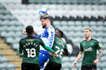 Stock Image of Max Ehmer of Bristol Rovers heads the ball