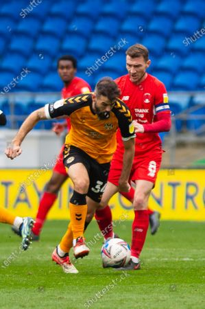 Stock Image of Joe Ledley of Newport County holds off Craig Clay of Leyton Orient
