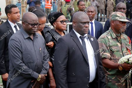 Widow Janeth Magufuli, center, arrives as the body of her husband and former president John Magufuli lies in state at Uhuru stadium in Dar es Salaam, Tanzania . Magufuli, a prominent COVID-19 skeptic whose populist rule often cast his country in a harsh international spotlight, died Wednesday aged 61 of heart failure, it was announced by Vice President Samia Suluhu Hassan, who was sworn-in as the country's new president on Friday