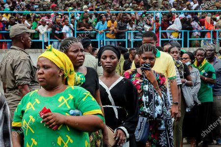 Mourners queue to pay their respects as the body of former president John Magufuli lies in state at Uhuru stadium in Dar es Salaam, Tanzania . Magufuli, a prominent COVID-19 skeptic whose populist rule often cast his country in a harsh international spotlight, died Wednesday aged 61 of heart failure, it was announced by Vice President Samia Suluhu Hassan, who was sworn-in as the country's new president on Friday