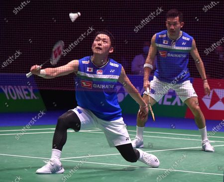 Japan's Takeshi Kamura, left, and Keigo Sonoda play a shot against Denmark's Kim Astrup and Anders Skaarup Rasmussen during the men's doubles semi final match on day four of the All England Open Badminton Championships at the Utilita Arena in Birmingham, England