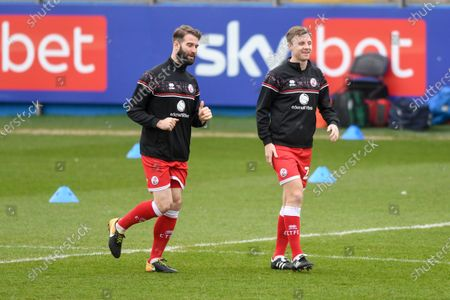 Stock Picture of Crawley Town defender Joe McNerney (5) and Crawley Town defender Tony Craig (24) gestures and reacts warming up during the EFL Sky Bet League 2 match between Barrow and Crawley Town at Progression Solicitors Stadium, Barrow
