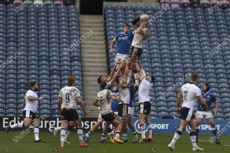 Italy's Johan Meyer, left, and Scotland's Grant Gilchrist jump to reach the ball during the rugby union international match between Scotland and Italy at the Murrayfield stadium in Edinburgh, Scotland