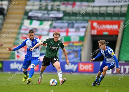 Stock Photo of Plymouth Argyle Forward Luke Jephcott (31) shields the ball fromBristol Rovers defender Max Ehmer (5)  during the EFL Sky Bet League 1 match between Plymouth Argyle and Bristol Rovers at Home Park, Plymouth
