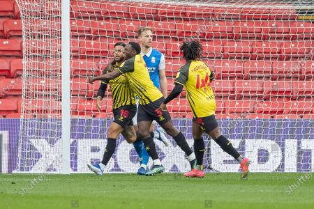 Andre Gray of Watford celebrates with Jeremy Ngakia of Watford  after Gray scores the  third goal for Watford