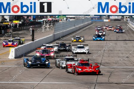 SEBRING INTERNATIONAL RACEWAY, UNITED STATES OF AMERICA - MARCH 20: #31 Whelen Engineering Racing Cadillac DPi, DPi: Start, Mike Conway, Felipe Nasr, Pipo Derani #10: Konica Minolta Acura ARX-05 Acura DPi, DPi: Ricky Taylor, Filipe Albuquerque, Alexander Rossi #01: Cadillac Chip Ganassi Racing Cadillac DPi , DPi: Renger van der Zande, Scott Dixon, Kevin Magnussen #48: Ally Cadillac Racing Cadillac DPi, DPi: Jimmie Johnson, Kamui Kobayashi, Simon Pagenaud #60: Meyer Shank Racing w/Curb-Agajanian Acura DPi, DPi: Olivier Pla, Dane Cameron, Juan Pablo Montoya during the Sebring 12 Hours at Sebring International Raceway on March 20, 2021 in Sebring International Raceway, United States of America. (Photo by Jake Galstad / LAT Images)