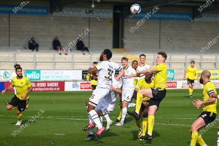 Hayden Carter of Burton Albion (17) and Cameron Jerome of Milton Keynes Dons (35) battle for a header during the EFL Sky Bet League 1 match between Burton Albion and Milton Keynes Dons at the Pirelli Stadium, Burton upon Trent