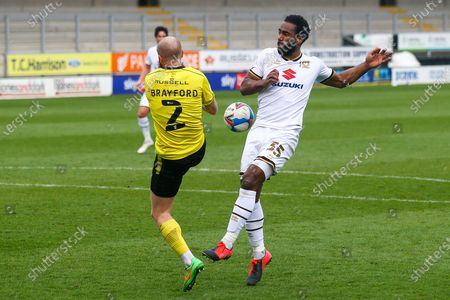 John Brayford of Burton Albion (2) and Cameron Jerome of Milton Keynes Dons (35) battle for the ball during the EFL Sky Bet League 1 match between Burton Albion and Milton Keynes Dons at the Pirelli Stadium, Burton upon Trent