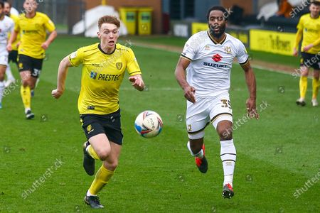 Hayden Carter of Burton Albion (17) and Cameron Jerome of Milton Keynes Dons (35) battle for the ball during the EFL Sky Bet League 1 match between Burton Albion and Milton Keynes Dons at the Pirelli Stadium, Burton upon Trent