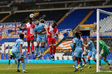 Anthony Stewart of Wycombe Wanderers rises highest to win a header