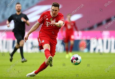 Bayern's Niklas Suele kicks the ball during the German Bundesliga soccer match between FC Bayern Munich and VfB Stuttgart in Munich, Germany