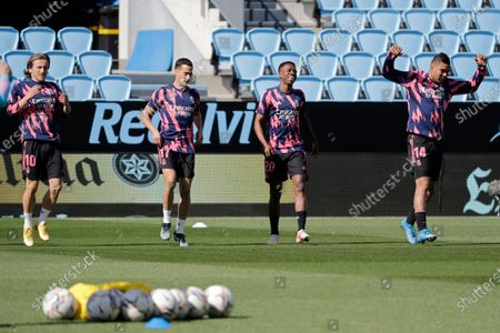 Real Madrid players warm up before a Spanish La Liga soccer match between Celta and Real Madrid at the Balaidos stadium in Vigo, Spain, . Left to right; Luka Modric, Lucas Vazquez, Vinicius Junior and Casemiro