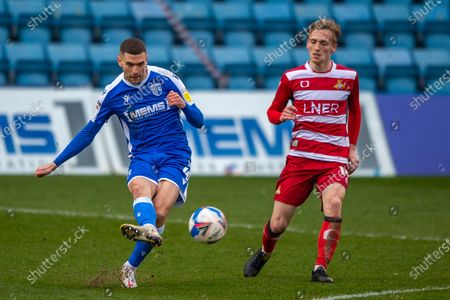 Gillingham FC midfielder Stuart O'Keefe (4) and Doncaster Rovers midfielder Matt Smith (14) during the EFL Sky Bet League 1 match between Gillingham and Doncaster Rovers at the MEMS Priestfield Stadium, Gillingham