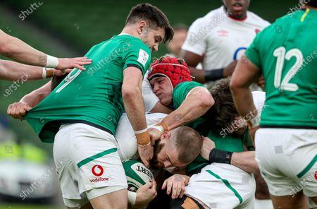 Ireland vs England. England's Luke Cowan-Dickie is tackled by Conor Murray and Josh Van der Flier of Ireland