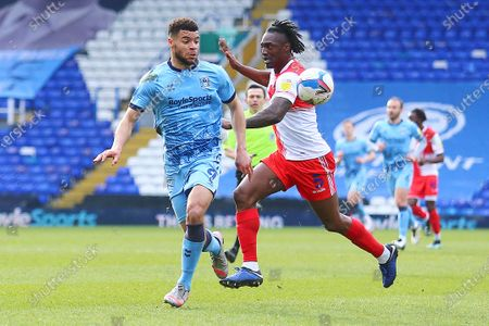 Wycombe Wanderers defender Anthony Stewart (5) holds off Coventry City forward Maxime Biamou (9) during the EFL Sky Bet Championship match between Coventry City and Wycombe Wanderers at the Trillion Trophy Stadium, Birmingham