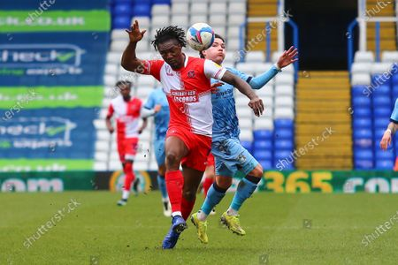 Wycombe Wanderers defender Anthony Stewart (5) and Coventry City midfielder Callum O'Hare (11) during the EFL Sky Bet Championship match between Coventry City and Wycombe Wanderers at the Trillion Trophy Stadium, Birmingham