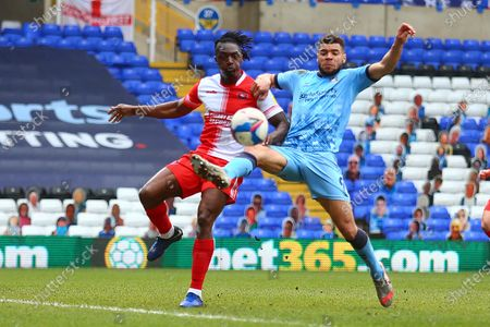Wycombe Wanderers defender Anthony Stewart (5) clears the ball away from Coventry City forward Maxime Biamou (9) during the EFL Sky Bet Championship match between Coventry City and Wycombe Wanderers at the Trillion Trophy Stadium, Birmingham