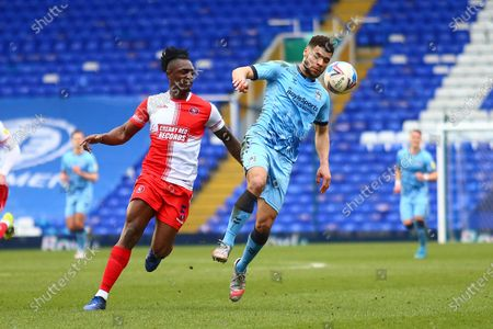 Wycombe Wanderers defender Anthony Stewart (5) and Coventry City forward Maxime Biamou (9) during the EFL Sky Bet Championship match between Coventry City and Wycombe Wanderers at the Trillion Trophy Stadium, Birmingham