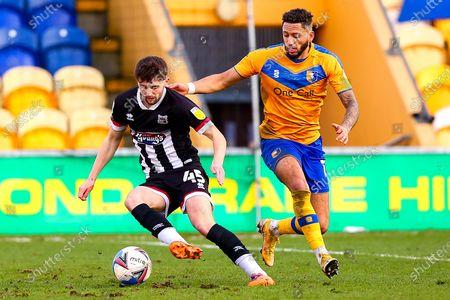 Kellan Gordon of Mansfield Town chases down Joe Adams of Grimsby Town