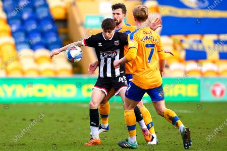 Joe Adams of Grimsby Town holds off pressure from Jake Wright of Mansfield Town