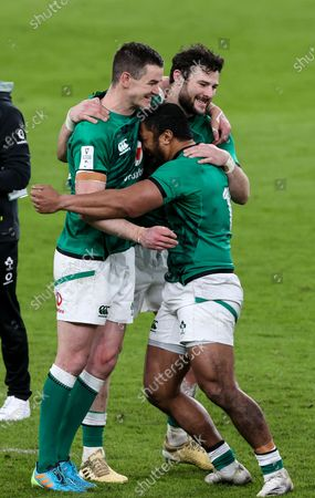 Ireland vs England. Ireland's Johnny Sexton, Robbie Henshaw and Bundee Aki celebrate after the game