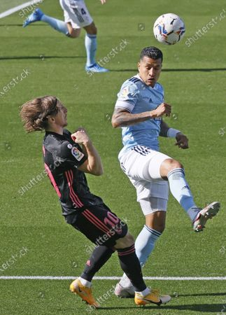 Celta's Colombian defender Jeison Murillo (R) duels for the ball against Real Madrid's Croatian midfielder Luka Modric (L) during the Spanish LaLiga soccer match between Celta de Vigo and Real Madrid at Balaidos stadium in Vigo, Galicia, Spain, 20 March 2021.