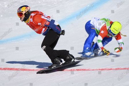 Winner Eva Samkova (L) of Czech Republic crosses the finish line in front of second placed Michela Moioli of Italy during the women's Snowboard Cross, at the FIS Snowboard Cross, SBX, World Cup Finals in Veysonnaz, Switzerland, 20 March 2021.